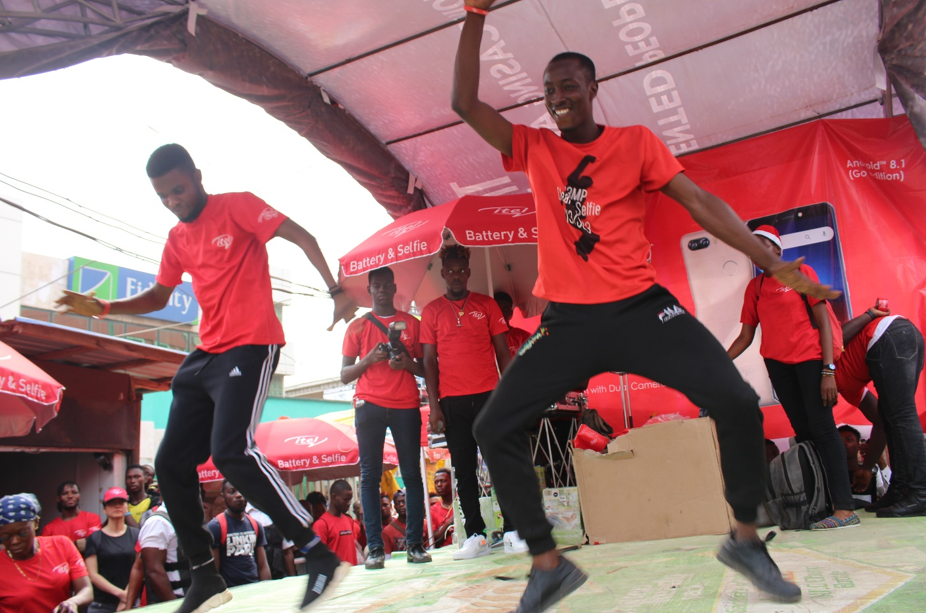 Whooping Discounts. Music. Funfair: Itel Mobile x Google shuts down Computer Village in a colorful blast carnival - Brand Spur