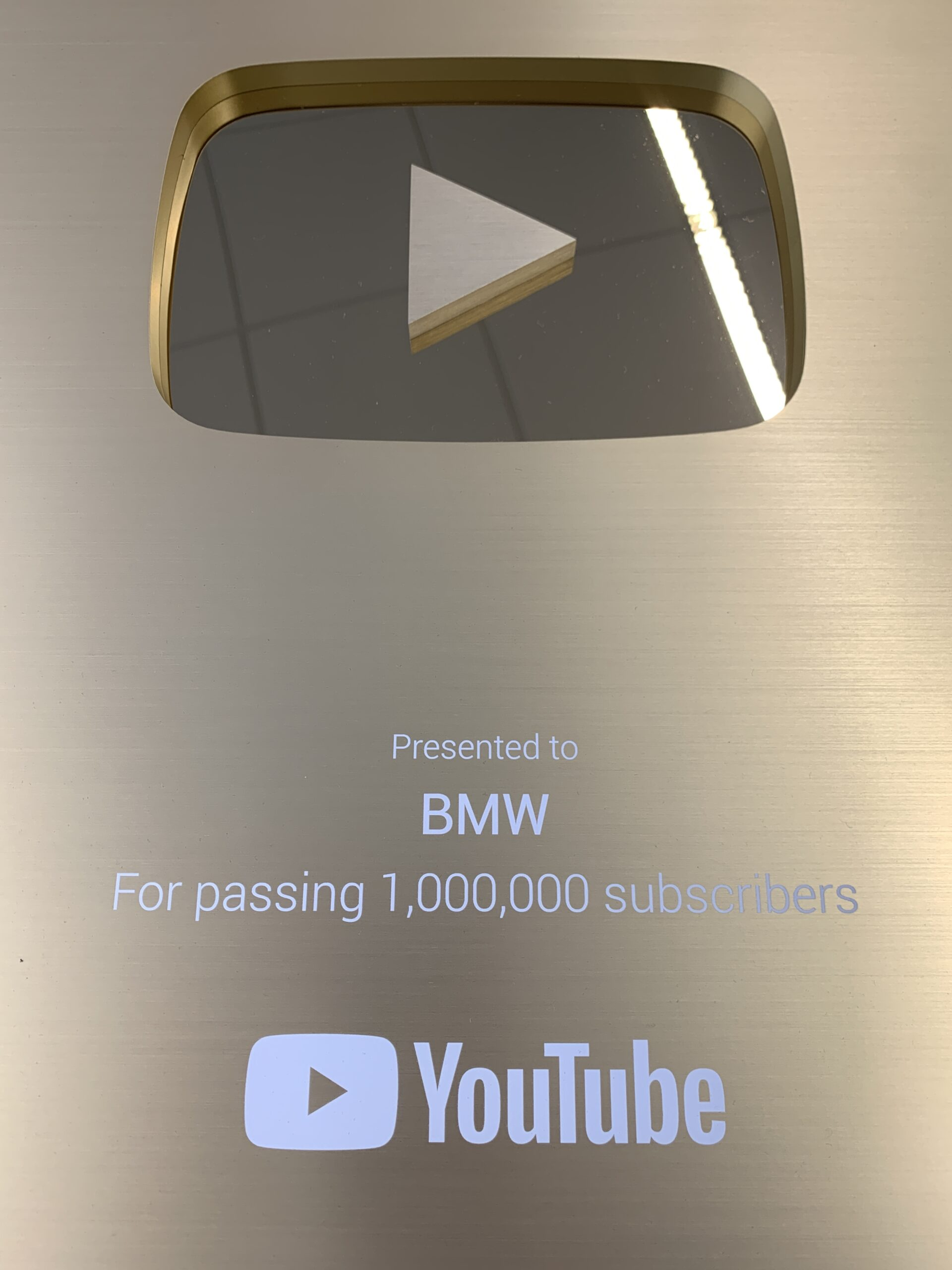 """YouTube presents BMW with the """"Golden Button Award""""."""