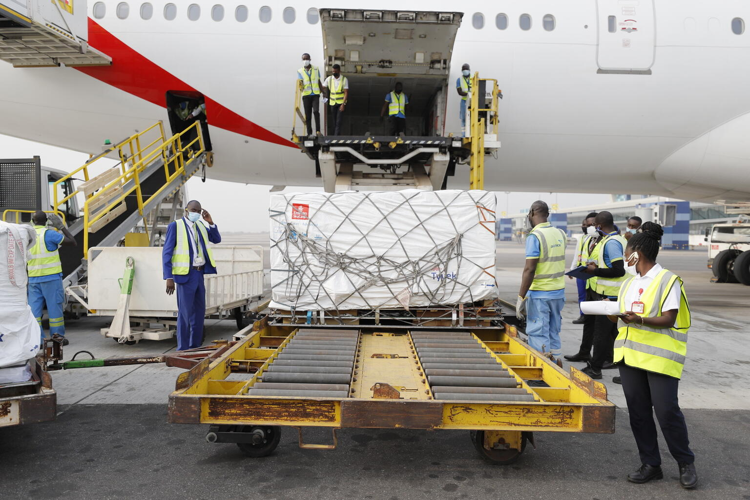 COVID-19 vaccine doses shipped by the COVAX Facility head to Ghana, marking beginning of global rollout